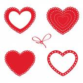Set of red hearts on a white background. — Stock Vector