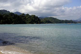 Beautiful beach with white sand, coast of Langkawi. — Stock Photo