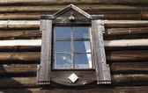 Old window on the wall of a wooden house. — Stok fotoğraf