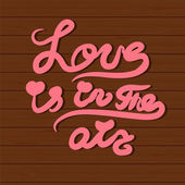 Vector card with hand lettering text All you need is love.  — Stock Vector