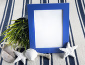 Beautiful collage with blue photo frame on old vintage rug. — Stock Photo