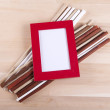 Beautiful composition with photo frames and fwooden sticks — Stock Photo #67888763