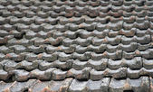 The roof of an old house covered with gray tiles — Stock Photo