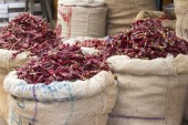 Dried red chili peppers in sacks in India Goa — Stock Photo