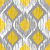 Ikat ethnic seamless pattern in blue and yellow colors — Stock Vector