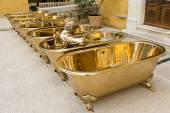 Brass Bathtubs and Statue — Stock Photo