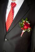 Grooms suit close up with a striped tie and buttonhole — Stock Photo