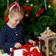 Girl near Christmas tree with gifts — Foto Stock #70388737