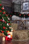 Christmas fur-tree in a rural interior — Stock Photo