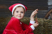 Little girl holding Christmas decoration — Stock Photo