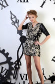 Beautiful woman on clockwork background — Stock Photo