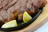 Stake from mutton with lemon — Stock Photo