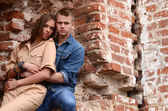 Enamoured couple near abandoned brick building — Stock Photo