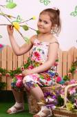 Little girl in country style — Stock Photo