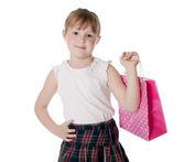 Girl holding pink shopping bag — Stock Photo