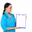 Medical doctor woman show empty blank clipboard — Stock Photo #69308617