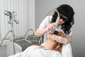 Woman having facial hair removal laser. — Stok fotoğraf