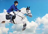 Equestrian sport: young girl in jumping show — Foto Stock