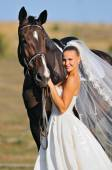Portrait of beautiful bride with horse — Stock Photo