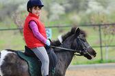 Little girl and pony — Stock Photo