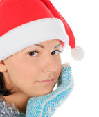 Yong female in santa hat over white — Stock Photo