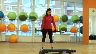 Young woman doing exercise with barbell — Stockvideo