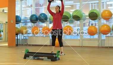 Young woman doing exercise with dumbbells — Stock Video