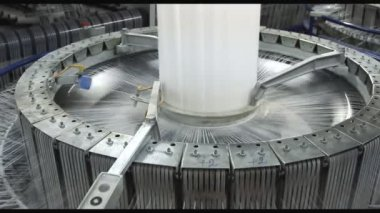 Textile industry - yarn spools on spinning machine in a factory — Vídeo de stock