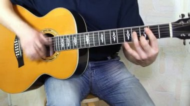 Musical instrument with guitarist hands — Stock Video