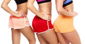 Sports woman bodies — Stock Photo
