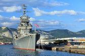 Battleship docked at a harbor — Stock Photo
