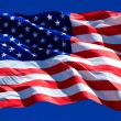 Flag of the USA against a blue sky — Stock Photo #53476161