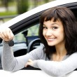 Pretty girl showing the car key — Stock Photo #70460633