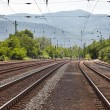 Railroad tracks with mountains — Stock Photo #76637857