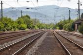 Railroad tracks with mountains — Stock Photo