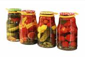 Pickled vegetables in banks — Stock Photo