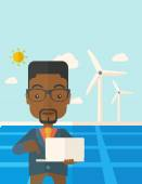 African man with laptop in solar panel. — Stock Vector