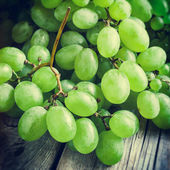 Grapes on wooden rustic table — Stock Photo