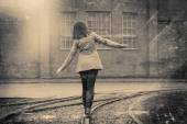 Girl walking on the railway, retro stylized photo — Stock Photo