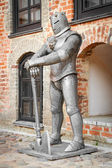 Medieval knight  near castle  — Stockfoto