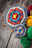 Knitted mandala and yarn — Stock Photo