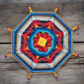 Knitted mandala on wooden plank — Foto Stock