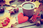 Warming coffee cup, red heart and autumn still life — ストック写真