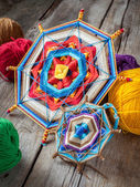 Two knitted tibetan mandala from threads and yarn, selective foc — Stock Photo