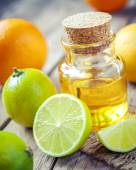 Citrus essential oil and slice of orange, lemon and lime fruits  — Stock Photo