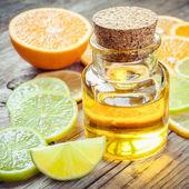 Citrus essential oil and slice of ripe fruits: orange, lemon and — Stock Photo