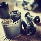 Old photo film rolls, cassette and retro camera. — Stock Photo