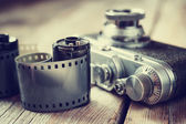 Old photo film rolls, cassette and retro camera, selective focus — Stock Photo