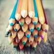 Colored Drawing Pencils on old desk. Vintage stylized image. — Stock Photo #58712149