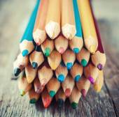 Colored Drawing Pencils on old desk. Vintage stylized image. — Stock fotografie